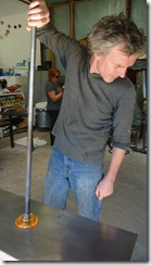 Tim Bassett, HGBS Glass Artist and Owner, prepping for a cane pull
