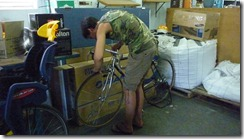 Chris working on Robert's bicycle