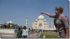 Finishing touches on Taj Mahal dome - typical pose at the Taj