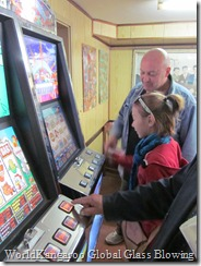 Afro and Amy playing electronic slot maching
