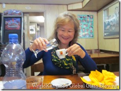 Jeannie trying grappe in her cappuccino