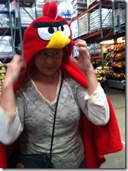 Trying on the Angry Bird blanket for size