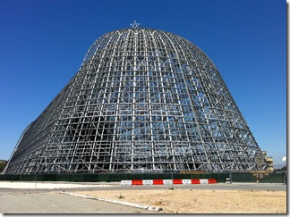 Moffett Field's blimp hangar being disassembled for hazard cleaning